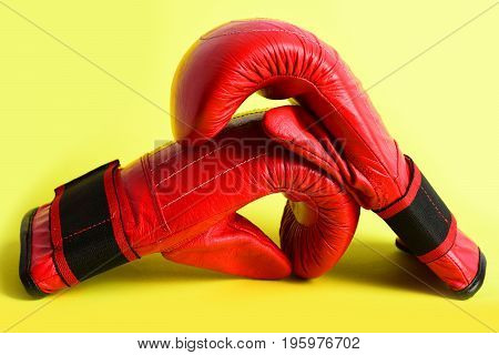 Boxing Mittens Made Of Leather In Red Colour On Yellow
