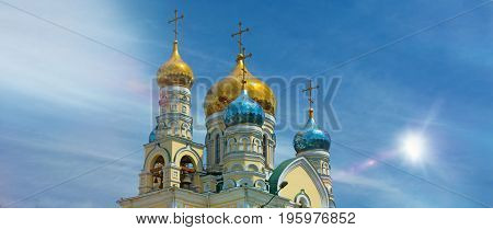 the domes of the Orthodox Church, amid blue skies, gleaming Golden domes. with the Sun