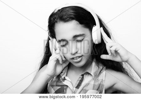Afro-american Little Girl With Headphones Listening To Music On White Background