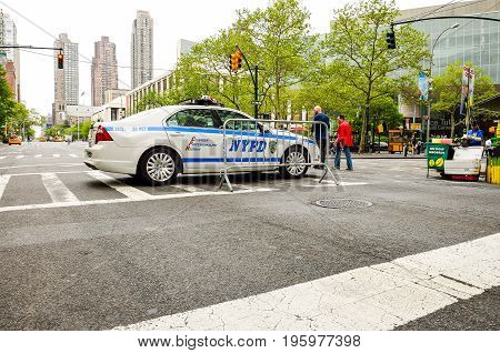 New York, Usa - May 10, 2014: Nypd Police Car On Street With Skyscrapers