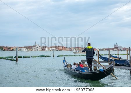 Venice, Italy - 20 May 2017 : View Of People On Gondola, With Building Along The Canal In Venice.