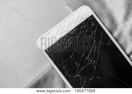 Broken mobile phone screen close-up black and white frame