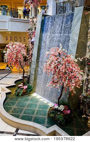 Las Vegas, Usa - May 7, 2014: Venetian Hotel Fountain Decorated With Flowers On Trees Inside Mall In