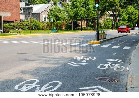 Montreal Canada - July 25 2014: Street road with separate lane for bicycles in downtown city