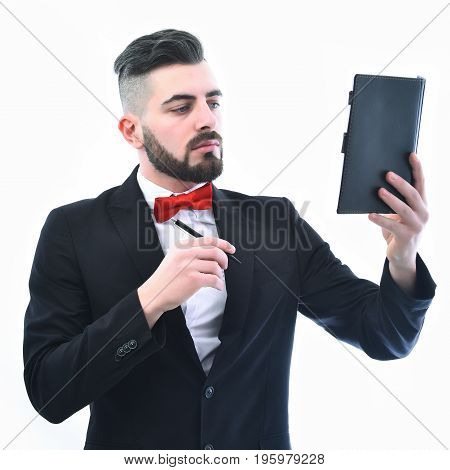 Successful Businessman With Beard And Serious Face Holds Black Organizer