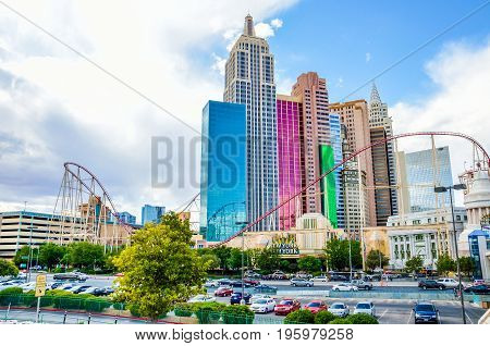 Las Vegas, Usa - May 7, 2014: Closeup Of New York Roller Coaster With Sign And Skyscrapers By Casino