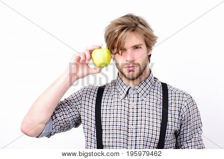Idea Of Proper Nutrition. Man With Beard Holds Green Apple