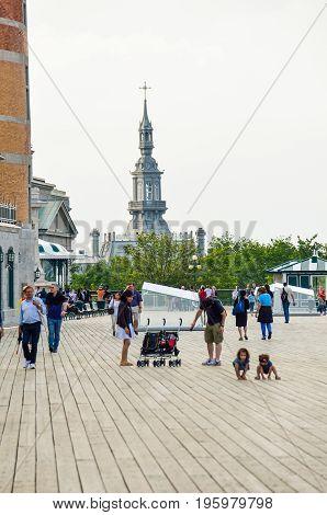 Quebec City, Canada - July 27, 2014: People Walking On Dufferin Terrace Boardwalk Street Close To Ch