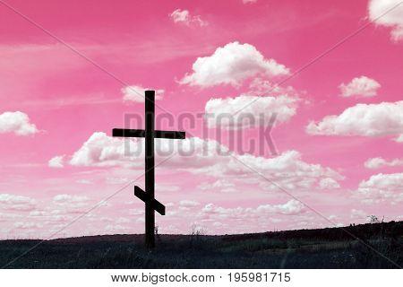Cross symbol of christian religion against the sky