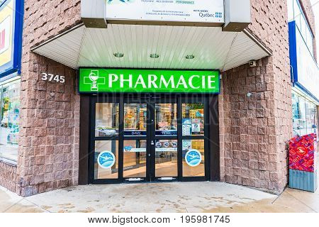 Montreal, Canada - May 26, 2017: Pharmacie Store Entrance And Sign Pharmacy In Downtown City During