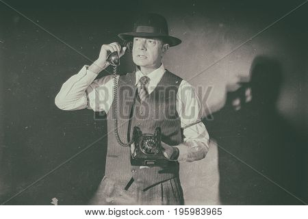 Antique Black And White Photo Of Angry Film Noir Man Calling With Old Phone.