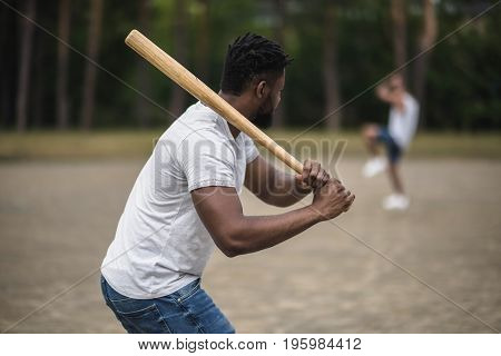 Young African American Men Playing Baseball On Court, Selective Focus