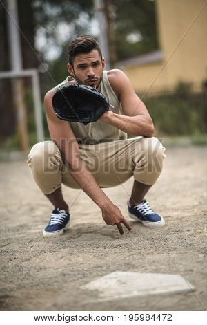 Young Handsome Baseball Player Ready To Catch Ball On Court