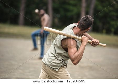 young multiethnic men playing baseball on court selective focus