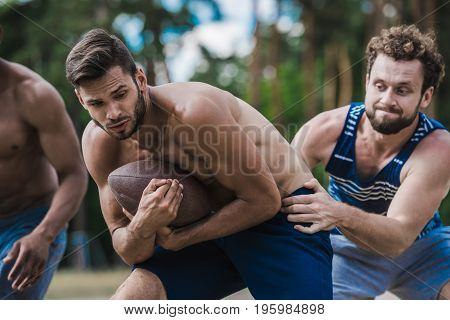 Group Of Young Handsome Men Playing Football On Court