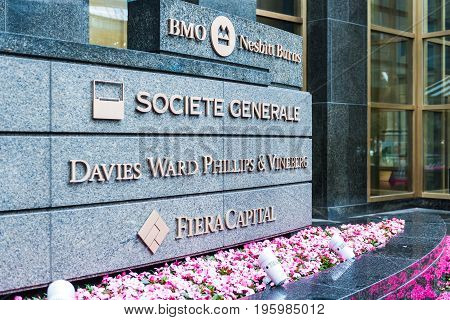 Montreal Canada - May 26 2017: Financial companies building entrance with signs in downtown area in Quebec region