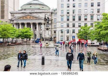 Montreal, Canada - July 26, 2014: Old Town Area With Centaur Theater And Statue Outside Notre Dame B