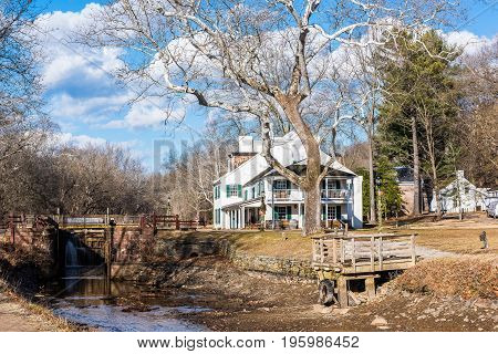 Great Falls National Park USA - December 29 2016: Great Falls Tavern Visitor Center by waterfall rapids in Virginia and Maryland