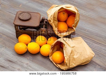 fresh oranges on the old weight scale
