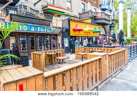 Montreal, Canada - May 26, 2017: Empty Restaurants Outside Seating Area With Tables On Saint Denis S