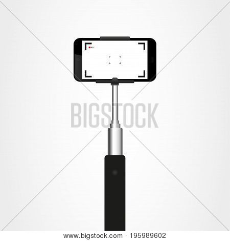 Selfie stick with the phone. Phone holder