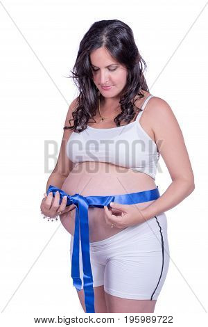 Pregnant woman with a blue cloth bow around her belly