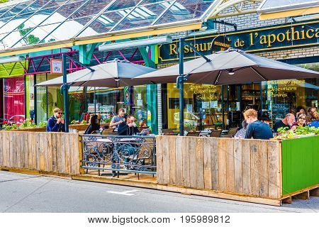Montreal Canada - May 27 2017: St Hubert street covered sidewalk with restaurant in Plateau neighborhood in city in Quebec region