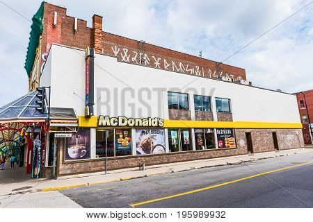 Montreal Canada - May 27 2017: McDonalds sign and logo by St Hubert street on Rue Beaubien in Plateau neighborhood in city in Quebec region