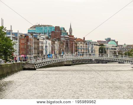 DUBLIN, IRELAND - NOVEMBER 05, 2013: Ha Penny Bridge, pedestrian cast-iron bridge, symbol of the Dublin