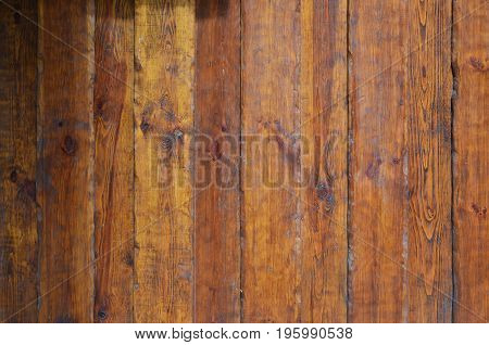 Texture Of The Old Wooden Wall From A Number Of Scratched Planks That Are Varnished