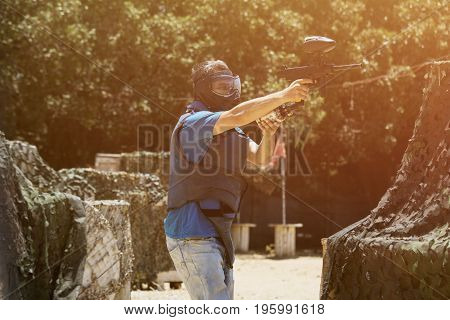 Guy with a paintball gun extreme sports