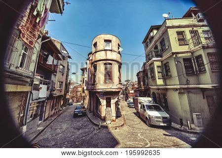 ISTANBUL, TURKEY - APRIL 29, 2017: Traditional stone street and houses at Fener district at Balat area. Balat is popular attraction in Istanbul.