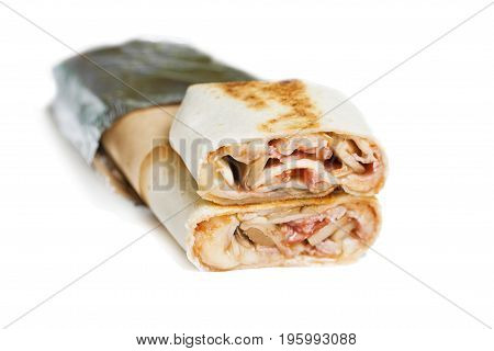 Beef shawarma or kebab wrap with vegetables. Isolated on white.