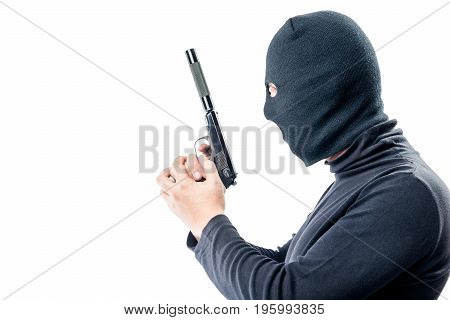 Killer With A Gun In Black Clothes Side View On A White Background