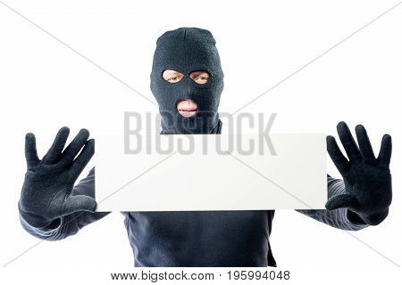 Robber In Black Clothes And Mask With A Poster In Hands On A White Background