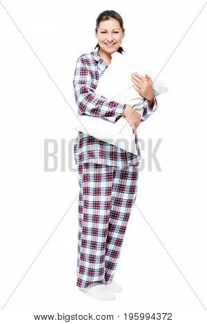 Girl With A Pillow In Full Length On A White Background, Dressed In Pajamas And Slippers