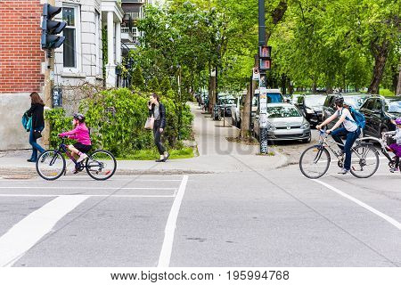 Montreal, Canada - May 27, 2017: Group Of People Family Riding On Bicycles In Plateau Neighborhood O