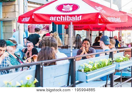 Montreal, Canada - May 27, 2017: People Sitting In Restaurant At Table In Outside Seating Area In Ga