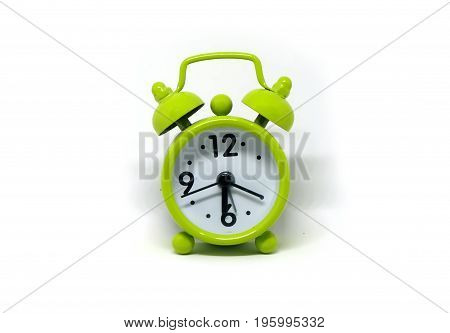 Green alarm clock,Retro alarm clock isolated on white background.