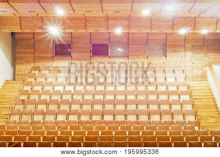 Gold wooden theater Seats, bright lights, stairs