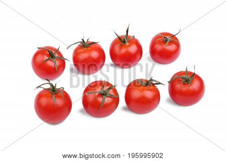 A group of fresh, ripe and bright red tomatoes with green leaves, isolated on a white background. Close-up of fresh, ripe tomatoes. Fresh cherry tomatoes. Healthy vegetables. Vegan food.