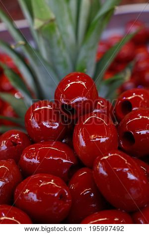Red Pitted Cerignola Olives In Oil Close Up