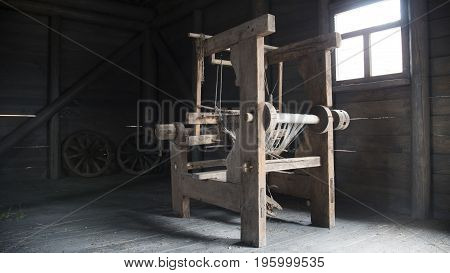 Old age wooden loom machine - manually operated mill machinery, close up