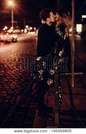 Passionate Lovers Sexually Kissing In Evening City Street At Road. Stylish Gypsy Couple In Love Embr