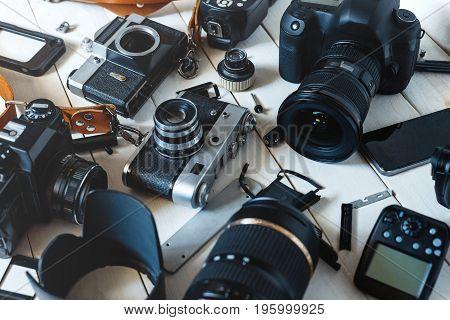 Vintage Film Camera Digital Camera And Smartphone On Wooden Background Technology Development Concept. Closeup
