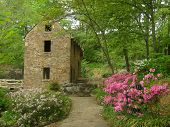 old stone mill and house in public park poster