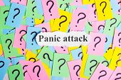 Panic Attack Syndrome text on colorful sticky notes Against the background of question marks poster
