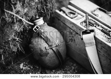 Old German Wehrmacht Times Of World War Ii Vintage Flask And Box Of Ammunition On Ground. Photo In B