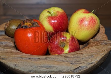 Close-up Of Fruits In A Wooden Bowl. Torfhaus, Germany