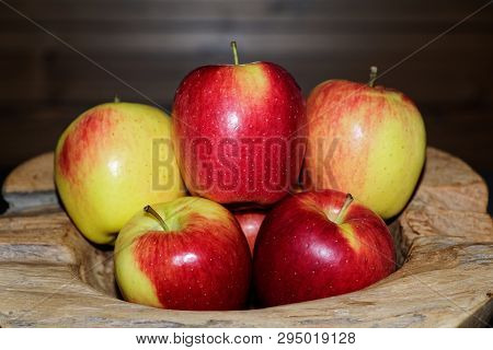 Close-up Of Ripe Red Yellow Apples In A Wooden Bowl. Torfhaus, Germany